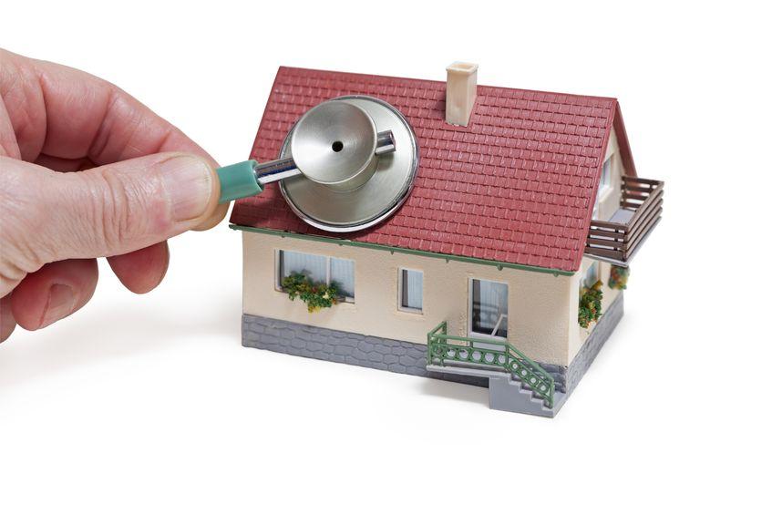 19595922 - house diagnostics  model house with hand and stethoscope on white background